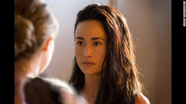 Tori Wu (Maggie Q) is a member of the Dauntless faction who administers Tris' aptitude test and knows that her results were inconclusive. As Tris becomes an initiate of Dauntless, Tori and her tattoo shop -- where other members trickle in for ink, since getting body art is one way to show bravery -- become a haven for Tris.