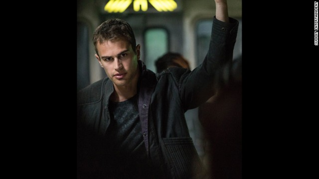 "Tobias, or ""Four"" (Theo James), teaches the Dauntless newcomers the ropes, and has a particular soft spot for Tris."