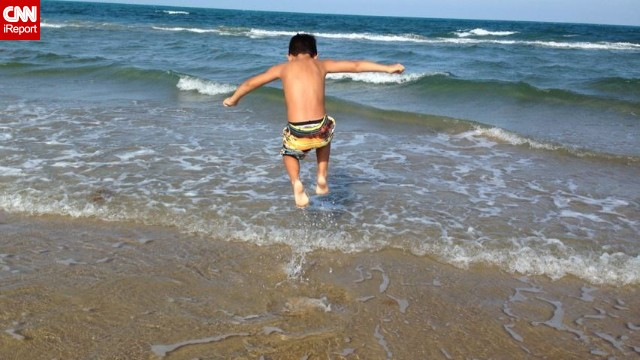 "<a href='http://ireport.cnn.com/docs/DOC-1096761 '>Gracen Stewart</a> says 5 or 6 years old is when kids start to notice where they are ""and can actually enjoy it."" Her son, Julian, was 6 when she took him to South Padre Island, Texas. ""The greatest part of this trip was seeing how happy he was,"" she said. ""He was able to jump around in the ocean and he loved it. We would walk out and as I held his hand, we'd both jump and let the waves knock us over."""