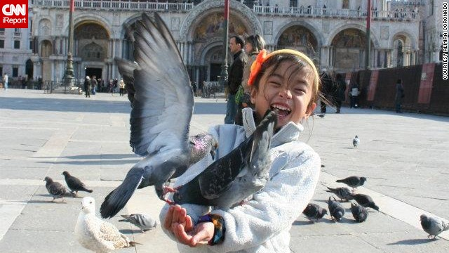 "CNN asked its readers to share their successes traveling with their children. <a href='http://ireport.cnn.com/docs/DOC-1096138'>Almira Coronado</a> and her husband took their daughter, Michelle, to Italy when she was 5, where her most memorable moment was feeding the pigeons at Piazza San Marco in Venice. ""My husband and I really try to explain new things to Michelle so that she knows what to expect or at least has a better understanding of what's going on."""