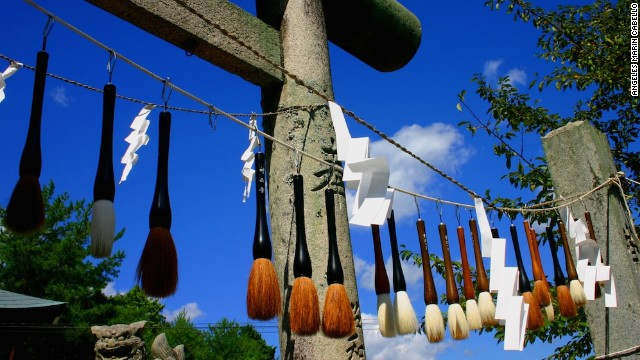 As part of Kumano, Japan's annual Brush Festival, a row of 10,000 brushes hangs along the 99-step path leading to the 10th-century Sakakiyama Shrine. Kumano has been renowned for its brush-making artisans since the end of Japan's Edo period.