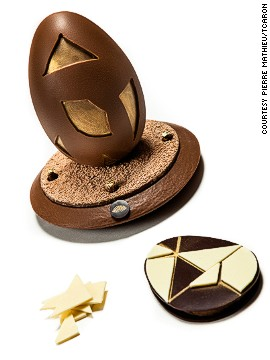 "<a href='http://www.flickr.com/photos/illycaffe/8232448586/' target='_blank'>Pierre Mathieu</a>, the head pastry chef at the Mandarin Oriental Paris, crafted 50 of these magical eggs using milk chocolate, white chocolate, praline peanut and gold decoration. Each egg required 90 minutes of work. Inspired by a Chinese tanagram puzzle, the lucky foodie can use seven pieces of white chocolate to form a shape on the egg's base. According to Mathieu: ""This was a good way to combine the French knowledge we use to make chocolate with Mandarin Oriental's Asian heritage."" Each egg costs around $95."