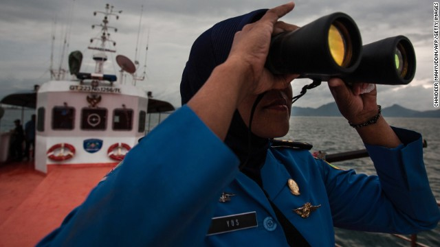 A member of Indonesia's National Search and Rescue Agency joins in a search for the missing plane in the Andaman