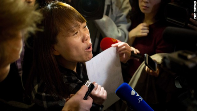 A relative of a missing passenger tells reporters in Beijing about a hunger strike to protest authorities' handling of information about the missing jet.