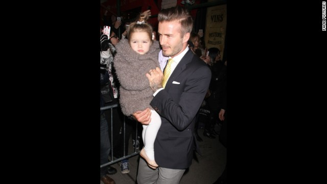 Beckham and his daughter, Harper, make their way through a crowd in New York in February. Harper, Beckham's fourth child, was born in 2011.