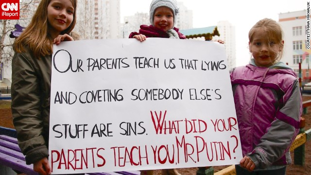 Ukrainian children in Kiev show off a sign they made in response to the Crimea referendum.