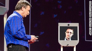Edward Snowden, on screen, talks from Russia with TED\'s Chris Anderson at the TED2014 conference.