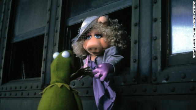 "By 1984's ""The Muppets Take Manhattan,"" Kermit and Piggy were finally making their unusual partnership official. <a href='https://www.youtube.com/watch?feature=player_embedded&v=bFw4L7-AFdw' target='_blank'>There was an elaborate song-and-dance number, </a>and the duo <a href='https://www.youtube.com/watch?v=g0P5FzSe3qw' target='_blank'>sang about how happy they'd make each other</a>. The ""Sesame Street"" crew risked not being able to find their way back home just to serve witness. All of that pomp and circumstance made us think the marriage was the real deal, but <a href='http://www.canadianliving.com/blogs/life/2014/03/18/miss-piggy-fashion-kermit-and-divas/' target='_blank'>Piggy has said</a> the minister officiating had ""been defrocked."""