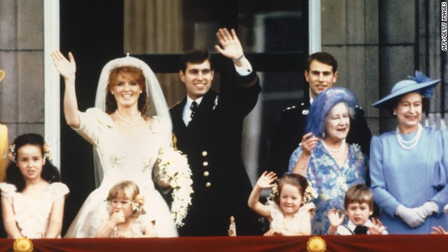 The newly wed Prince Andrew, the Duke of York and his wife Sarah Ferguson, the Duchess of York, wave to crowds July 23, 1986 from the balcony of Buckingham Palace in London while Queen Elizabeth II and Queen Mother look on.