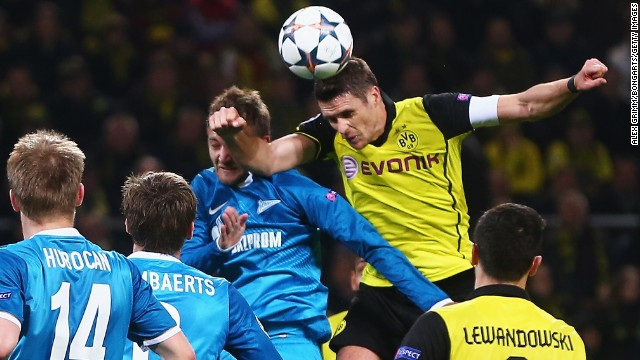 Sebastian Kehl scored for Borussia Dortmund as the 2013 finalist advanced past Zenit St. Petersburg in the other Champions League game. Dortmund lost 2-1 Wednesday but went through 5-4 on aggregate.