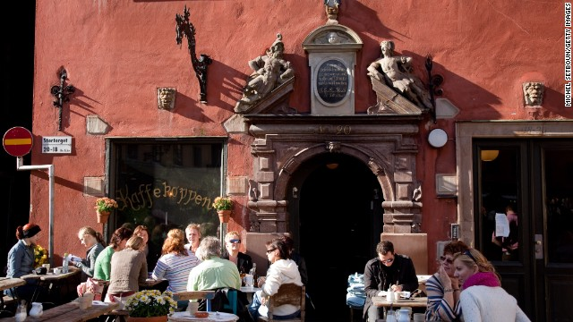 In Sweden, the fifth-happiest country, delight in the medieval architecture of Stockholm's Gamla Stan, a historical city center.