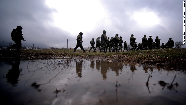 Russian soldiers patrol the area surrounding a Ukrainian military unit in Perevalne on Thursday, March 20.