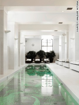 The spare pool at the Waldorf Astoria Chicago has an unexpected rose-tiled floor.