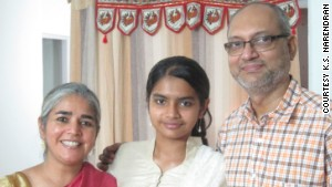 Chandrika Sharma, left, was on Flight 370; her daughter Meghna and husband K.S. Narendran wait patiently, trying to manage their anxiety and longing for her return.\n
