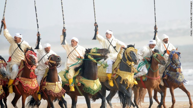 Moroccan horsemen ride along Essaouira's beach<!-- --> </br>at the 2012 Gnaoua World Music Festival.