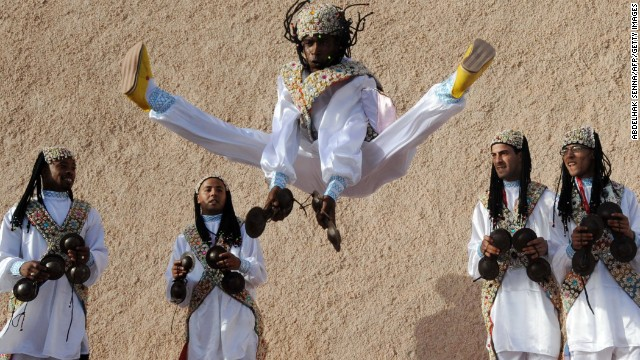 There's more to Essaouira than surfing. The historic town is known for its Gnawa, or Gnaoua, music, which originated in West Africa. Pictured, members of a Gnaoua troupe parade along a street in Essaouira ahead of the Gnaoua World Music Festival.