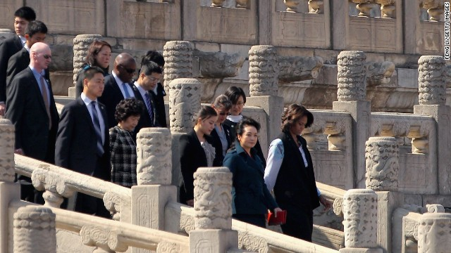 First Lady Michelle Obama visits the Forbidden City with Peng Liyuan, wife of Chinese President Xi Jinping, behind Mrs. Obama, on March 21, 2014, in Beijing. The first lady's visit is on educational and cultural exchanges. Click through the gallery to see her other international travel.