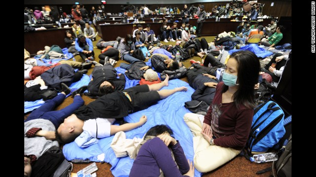 More than 200 people, mostly students, occupy Taiwan's Parliament building in Taipei on Friday, March 21.