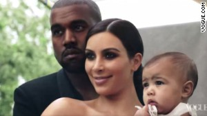 Kanye West poses with Kim Kardashian and daughter, North.