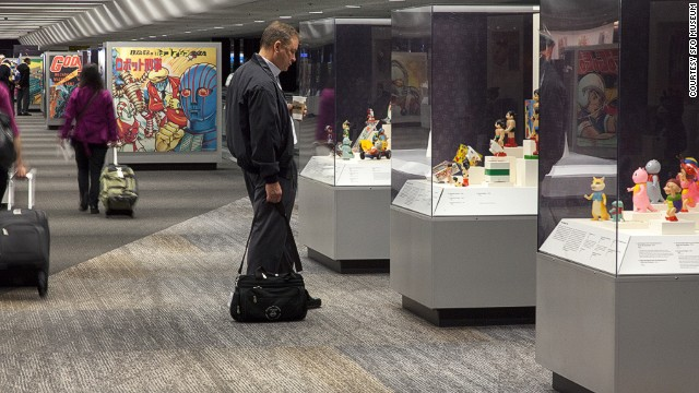 Astro Boy captures the attention of an SFO Terminal 3 traveler. Museum exhibits are becoming the norm at many U.S. airports, but San Francisco's is the only one accredited by the American Alliance of Museums.