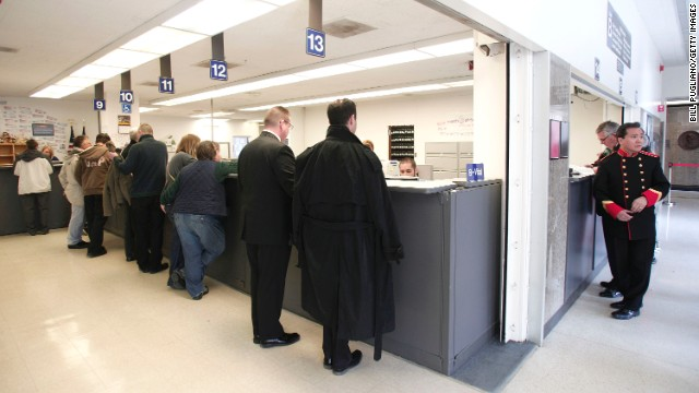 Same-sex couples get their marriage licenses at the Oakland County Courthouse in Pontiac, Michigan, on Saturday, March 22, a day after a federal judge overturned Michigan's ban on same-sex marriage.