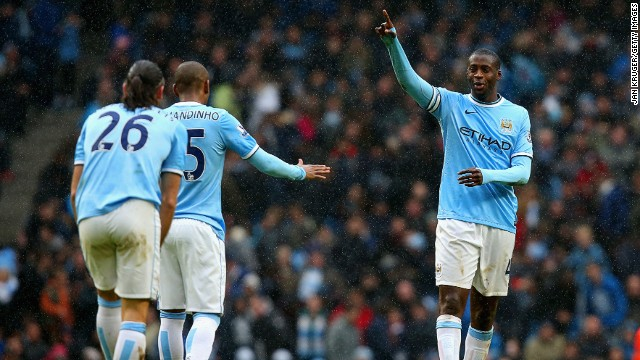 Yaya Toure (right) scored a hat-trick as Manchester City beat Fulham 5-0 at the Etihad Stadium. The Sky Blues' other goals came from Fernandinho and Martin Demichelis (both pictured).