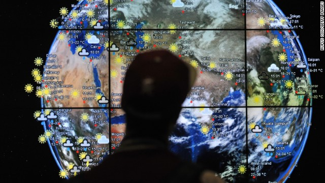 A passenger views a weather map in the departures terminal of Kuala Lumpur International Airport on Saturday, March 22.
