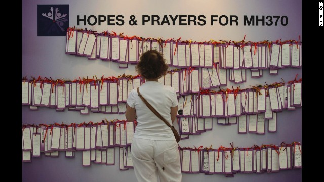 A woman reads messages for missing passengers at a shopping mall in Kuala Lumpur on March 24.