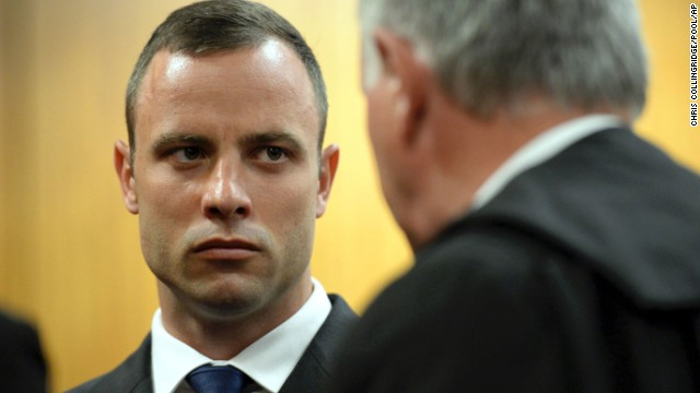 Pistorius talks to defense attorney Barry Roux on March 24.
