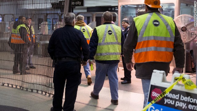 Chicago Transit Authority employees work the scene of the derailment.