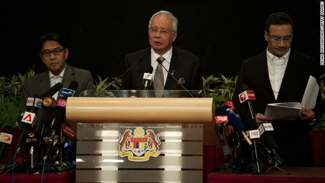 "Malaysian Prime Minister Najib Razak, center, delivers a statement about the flight March 24 in Kuala Lumpur. Razak's announcement came after the airline sent a text message to relatives saying it ""deeply regrets that we have to assume beyond any reasonable doubt that MH 370 has been lost and that none of those onboard survived."""