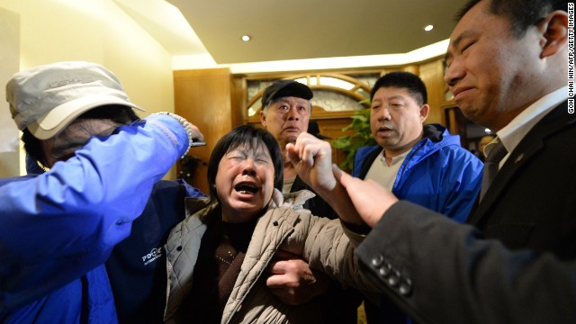 Angry relatives of those aboard Malaysia Airlines Flight 370 react in Beijing on Monday, March 24, after hearing that the plane went down over the southern Indian Ocean, according to analysis of satellite data.