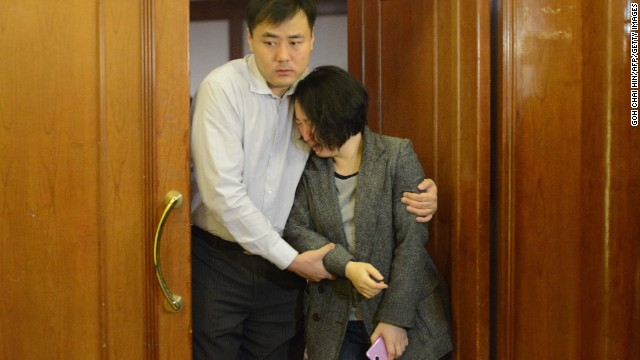 Grieving relatives of missing passengers leave a hotel in Beijing on March 24.