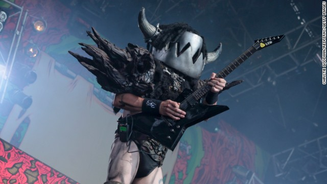 Mike Derks performs as Balsac the Jaws of Death, the group's rhythm guitarist. He has a face resembling a bear trap.