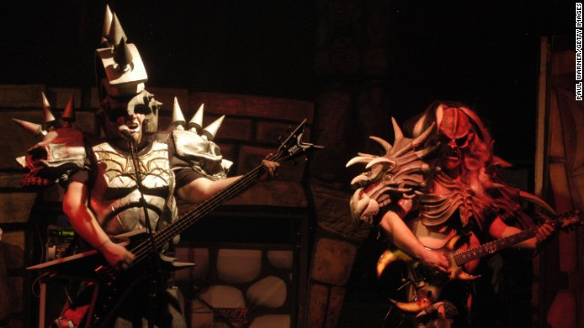 Bassist Jamison Land performs as Beefcake the Mighty, left, alongside lead guitarist Cory Smoot, or Flattus Maximus. While on tour in November 2011, Smoot died of a coronary artery thrombosis brought on by a heart condition, the coroner said. He was 34.