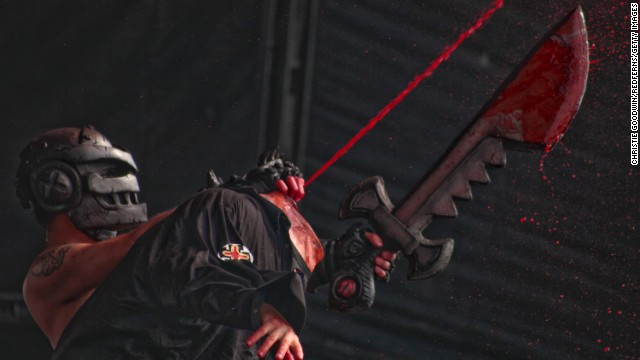 A simulated decapitation takes place on stage.