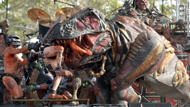 The band's resident dinosaur, Gor-Gor, wreaks havoc on stage.