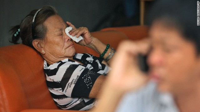 The mother of a passenger who was on Malaysia Airlines Flight 370 cries at her home in Medan, Indonesia, on March 25.
