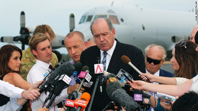 Australian Defense Minister David Johnston speaks to the media March 25 about the search for the missing jet.