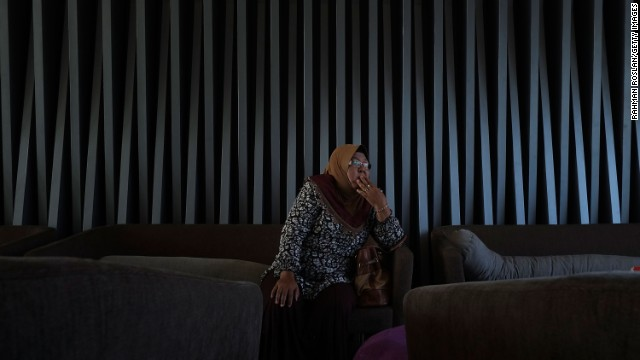 A family member of a missing passenger reacts after hearing the latest news March 25 in Kuala Lumpur.