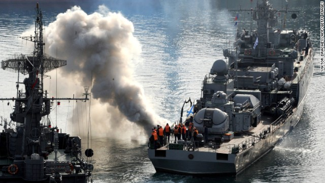 Russian sailors stand on the deck of the corvette ship Suzdalets in the bay of Sevastopol, Crimea, on March 25.