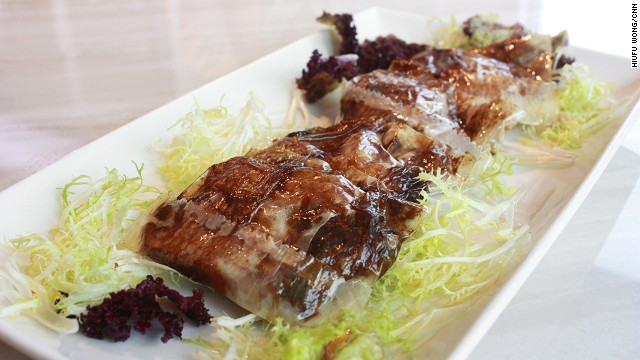 Ribs are packed in baking paper with chu hou paste -- a braising sauce made of condiments like soy, sugar and garlic -- before they're deep fried. The result is a savory and juicy slice of pork locked in a paper pocket. Tsui Hang Village only occasionally has this one on the menu.