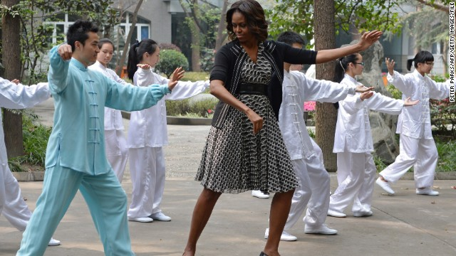 Michelle tries her hand at tai chi, while visiting a high school in Chengdu.