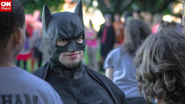 "Austin, Texas resident <a href='http://ireport.cnn.com/docs/DOC-1111420'>Eli Vizcaino</a>, seen here dressed as Batman, credits the character with helping him ""find his voice."" Vizcaino had a speech impediment as a child, and when he read Batman stories aloud as therapy, they freed his imagination."