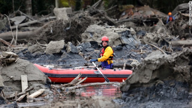 A search-and-rescue worker looks for survivors on March 25.
