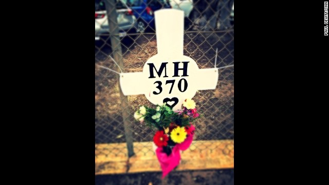 """Flower memorial sits on the fence of RAAF Pearce in Perth. It is dedicated to those 239 people who lost their lives on flight MH370."" By CNN's Paul Devitt, March 26. Follow Paul on Instagram at instagram.com/devohk."