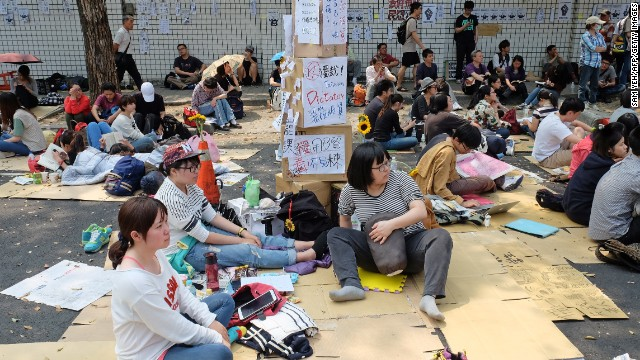 Protesters who oppose the trade agreement sit outside the Legislature during a demonstration in Taipei on Wednesday, March 26.