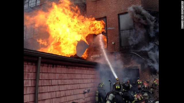 Firefighters work to douse the flames.