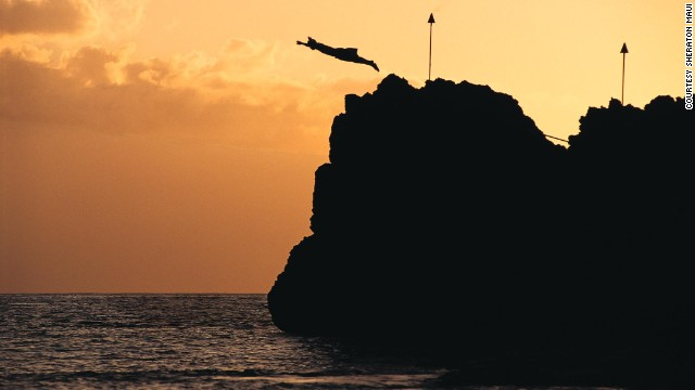 At the Sheraton Maui Resort & Spa, a diver celebrates the Hawaiian tradition of Lele Kawa, or cliff jumping.