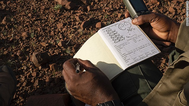 The guide records the GPS position in his logbook. It's been a good day. Rangers in Damaraland are proud of their job and the community looks up to them.